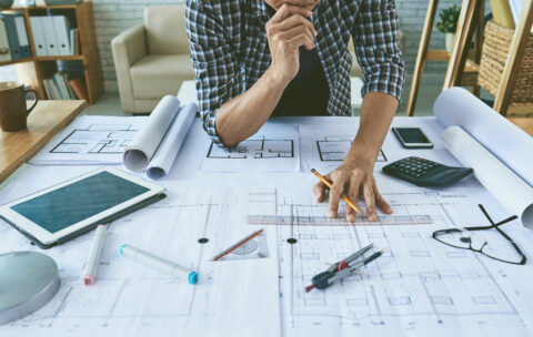 Cropped,Image,Of,Architect,Working,With,Construction,Plans